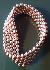 about 100 magnet balls arranged to form a Mobius strip