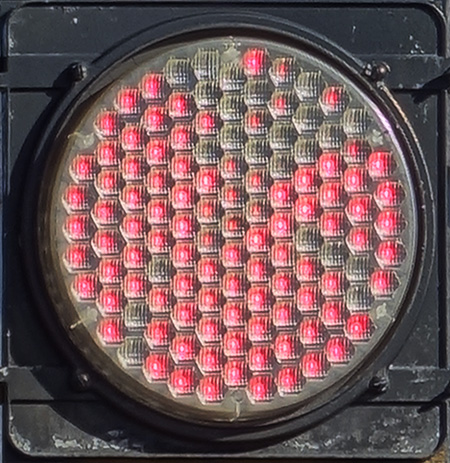 red traffic light with about 20 dark pixels; location: Medford Square, Medford MA