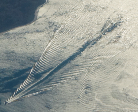 closeup of boat wakes and wave interference