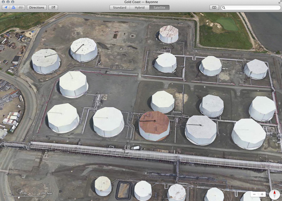 Bayonne tank farm as seen in Apple Maps satellite view, showing tanks as irregular polyhedral appoximations to a cylinder