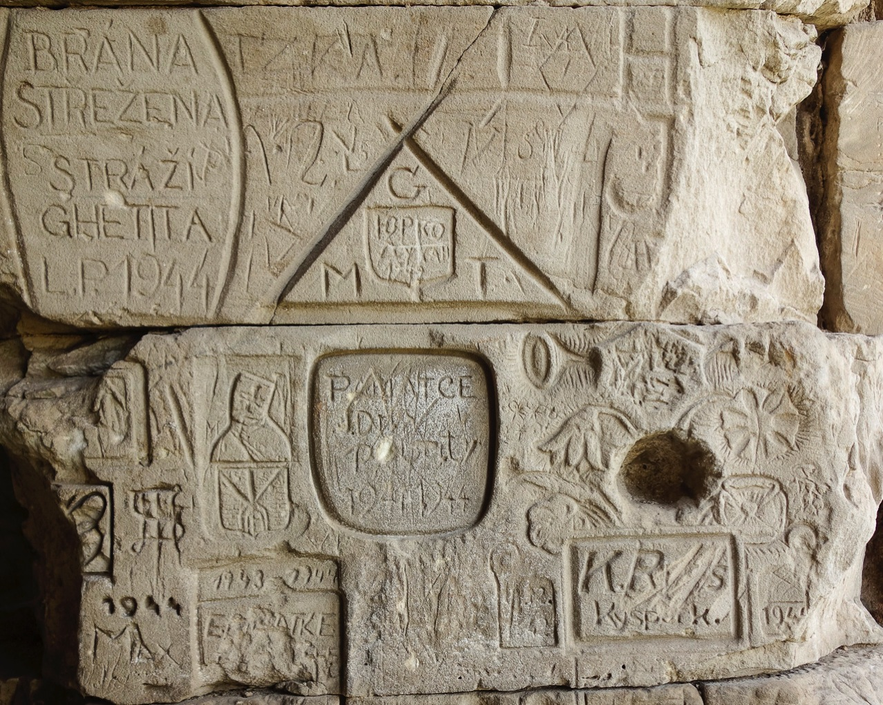Carvings in upper portion of the south wall of moat tunnel at Terezin