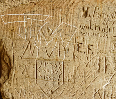 Postwar graffiti: lovers in 1953, a recent scrawl