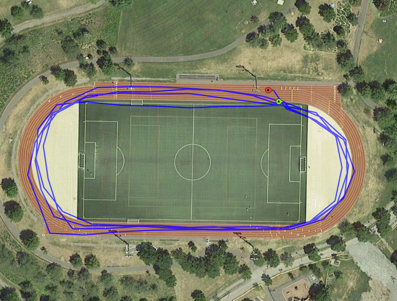 Google maps satellite view of Danehy Park track, with overlay of GPS-recorded trajectory of four laps