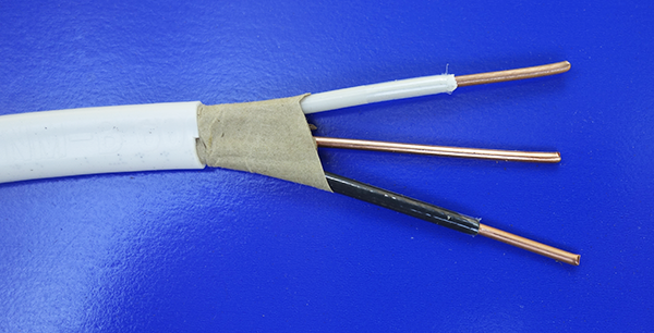 stripped end of 14/2 Romex cable: two insulated 14-gauge conductors with bare ground wire
