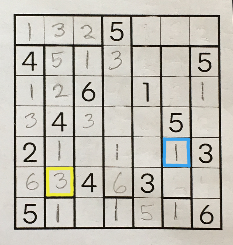 The same partially completed puzzle grid, with two squares marked by blue and yellow outlines.