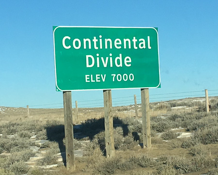 sign at the continental divide, elevation 7000