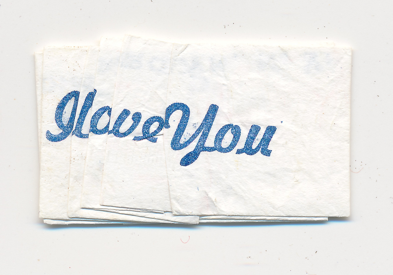 """It's a Pleasure to Serve You"" folded to read ""I love You"""